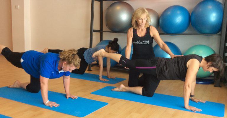 Tutor instructing Pilates
