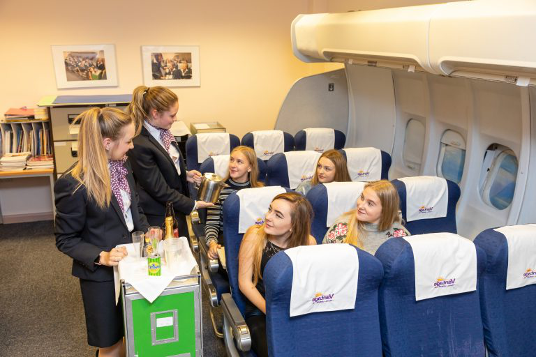 Travel 和 tourism students in the airplane classroom at our Paignton campus.