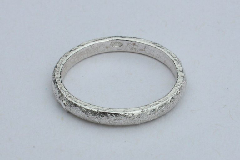Textured silver ring.