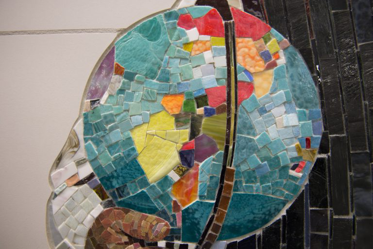 Mosaics made out of recycled materials made to look like the shape of the earth.
